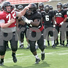 Monica Maschak - mmaschak@shawmedia.com<br /> Offensive lineman Ben Maruska and defensive tackle Cornelius Henry struggle in a friendly competition of offense versus defense during a practice at Huskie Stadium on Tuesday, August 13, 2013.