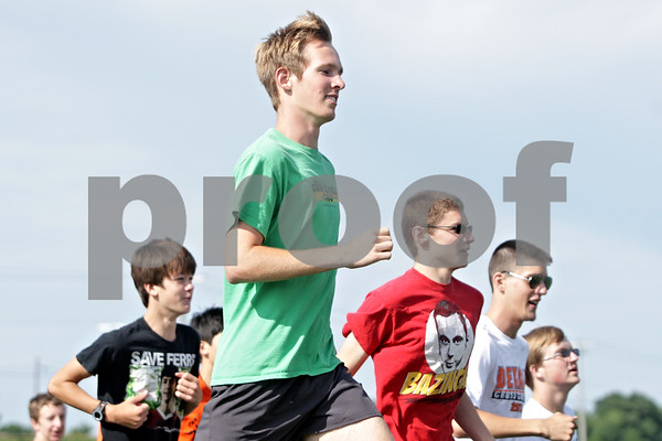 Rob Winner – rwinner@shawmedia.com<br /> <br /> Senior and co-captain of the DeKalb cross country team Isaac Hietanen (front) runs with his teammates during practice at the high school on Thursday, Aug. 15, 2013.