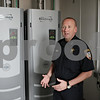 Rob Winner – rwinner@shawmedia.com<br /> <br /> Chief Gene Lowery discusses the new heating, ventilation, and air conditioning components used in the building of the new DeKalb police station located on Lincoln Highway on Monday, Aug. 12, 2013.