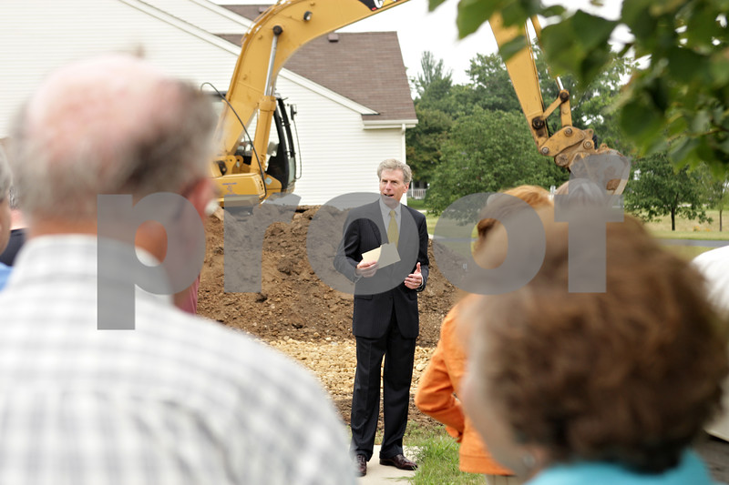 Rob Winner – rwinner@shawmedia.com<br /> <br /> Scott Pfisterer, the executive vice president of Shodeen Homes, speaks to members of the chamber of commerce, city officials as well as realtors and brokers before a groundbreaking ceremony for the reopening and development of homes in the Reston Ponds of Sycamore subdivision on Tuesday, Aug. 6, 2013.
