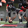 Rob Winner – rwinner@shawmedia.com<br /> <br /> Northern Illinois' Brian Mayer prepares to snap the ball during practice at Huskie Stadium in DeKalb, Ill., Tuesday, Aug. 13, 2013.