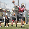 Monica Maschak - mmaschak@shawmedia.com<br /> Quarterback Nick Feuerbach passes the ball during the first day of practice for the Sycamore Varsity Football team on Wednesday, August 14, 2013.