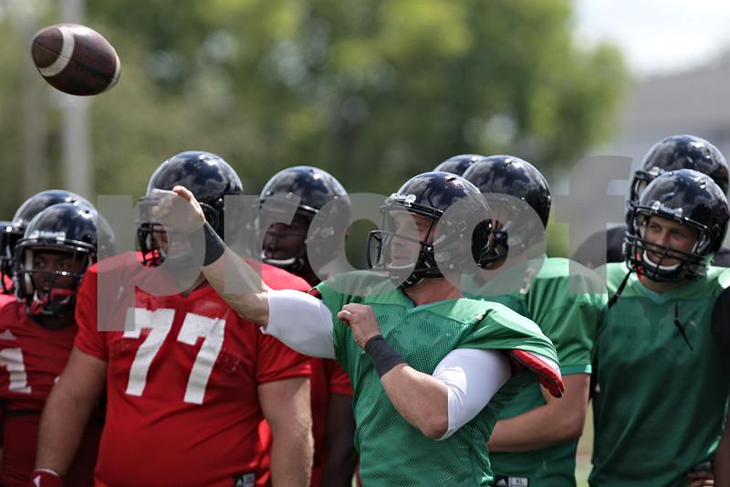Rob Winner – rwinner@shawmedia.com<br /> <br /> Northern Illinois quarterback Jordan Lynch passes the ball during practice at Huskie Stadium in DeKalb, Ill., Tuesday, Aug. 13, 2013.