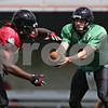 Rob Winner – rwinner@shawmedia.com<br /> <br /> Northern Illinois quarterback Drew Hare hands off the ball during practice at Huskie Stadium in DeKalb, Ill., Tuesday, Aug. 13, 2013.
