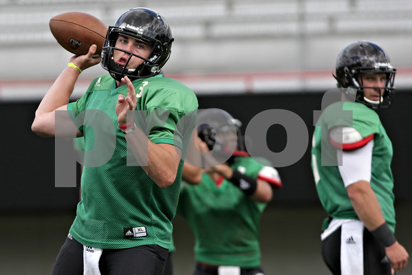 Rob Winner – rwinner@shawmedia.com<br /> <br /> Northern Illinois quarterback Drew Hare passes the ball during practice at Huskie Stadium in DeKalb, Ill., Tuesday, Aug. 13, 2013.