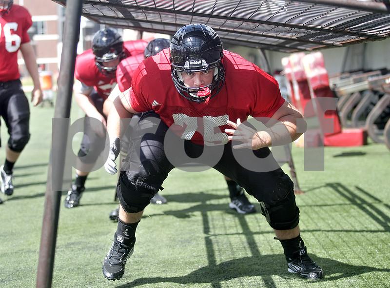Monica Maschak - mmaschak@shawmedia.com<br /> Offensive Lineman Wes Ott completes a drill during a practice at Huskie Stadium on Tuesday, August 13, 2013.