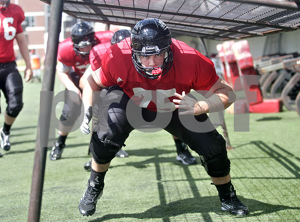 Monica Maschak - mmaschak@shawmedia.com<br /> Offensive Lineman Wes Ott completes a drill during a practice at Huskie Stadium on Tuesday, August 13, 2013.