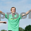 Rob Winner – rwinner@shawmedia.com<br /> <br /> Senior and co-captain of the DeKalb cross country team Isaac Hietanen warms up at the start of practice at the high school on Thursday, Aug. 15, 2013.