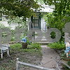 Monica Maschak - mmaschak@shawmedia.com<br /> The property at 509 North 7th Street and Fisk Avenue before volunteers spent four hours clearing foliage.