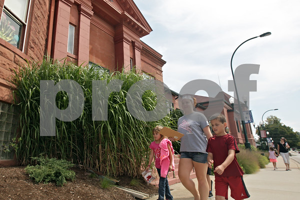 Rob Winner – rwinner@shawmedia.com<br /> <br /> (From left to right) Brylee Honiotes, 7, Kelly Culton, and Joey Yates, 7, walk past the Sycamore Public Library during a scavenger hunt presented by the Sycamore History Museum on Thursday, Aug. 15, 2013.