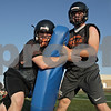 Rob Winner – rwinner@shawmedia.com<br /> <br /> Easton Norman (left) participates in a tackling drill with Tanner Pumfrey during DeKalb's first practice of the season on Wednesday, Aug. 14, 2013.