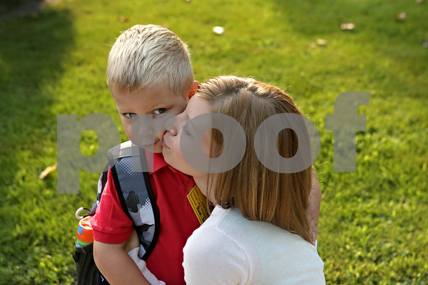 "Rob Winner – rwinner@shawmedia.com<br /> <br /> Brooke Bright gives a kiss to her son, Lucas Bright, 5, on the cheek before Lucas' first day of kindergarten at Davenport Elementary School in Genoa, Ill. on Friday morning. ""I'm not going to cry. Got to hold it together,"" said Brooke to her self as Lucas entered the building."