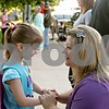 Rob Winner – rwinner@shawmedia.com<br /> <br /> Before her first day of school as a kindergartner on Friday morning at Davenport Elementary School in Genoa, Abigail Corbett, 5, is encouraged by her mother, Angela Corbett. Abigail is Angela's third and last child to begin school.