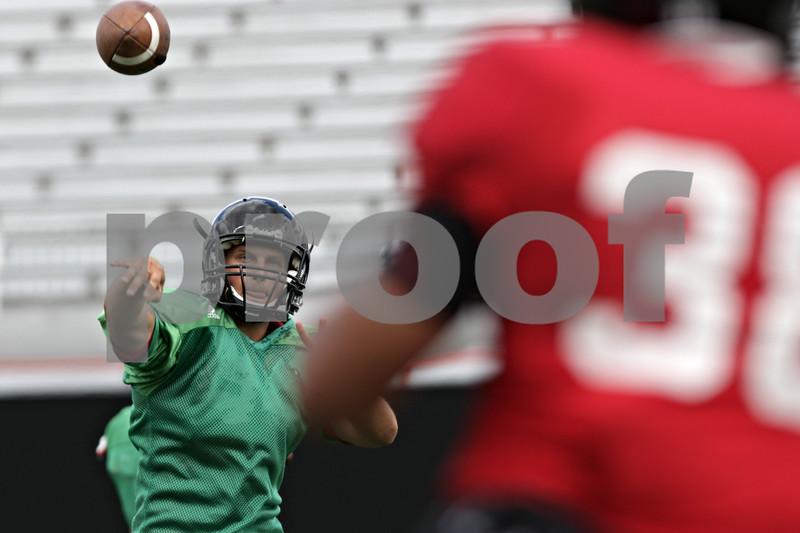 Rob Winner – rwinner@shawmedia.com<br /> <br /> Northern Illinois quarterback Matt McIntosh passes the ball during practice at Huskie Stadium in DeKalb, Ill., Tuesday, Aug. 13, 2013.
