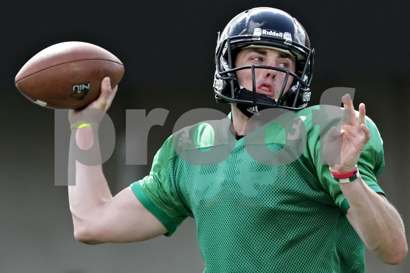 Rob Winner – rwinner@shawmedia.com<br /> <br /> Northern Illinois quarterback Drew Hare passes the ball during practice at Huskie Stadium in DeKalb, Ill., Tuesday, Aug. 13, 2013.