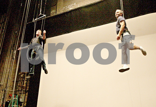 Monica Maschak - mmaschak@shawmedia.com<br /> Simon Fon (left), of Toronto, Ontario, and Scott Wirtz-Olsen, of Wisconsin, practice being lifted over the stage at a conference held by the North American Association of Flying Effects Directors at the Egyptian Theatre on Wednesday, August 14, 2013.