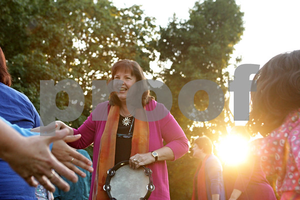 Rob Winner – rwinner@shawmedia.com<br /> <br /> Member of the musical group Cymbal and DeKalb Unitarian Universalist minister Linda Slabon shakes hands with the audience as part of a performance at the Sycamore History Museum on Wednesday, Aug. 14, 2013. Formed in 2001, Cymbal sings to build bridges, deepen compassion, and advocate for those beat down in body or spirit.