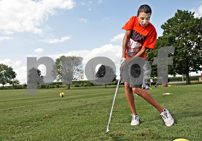 Monica Maschak - mmaschak@shawmedia.com<br /> Sophomore Peyton Gatz hits range balls during a practice for the Indian Creek golf team at Indian Oaks Country Club on Friday, August 16, 2013.