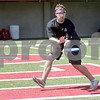 Monica Maschak - mmaschak@shawmedia.com<br /> Senior Kris Cherney catches a frisbee with a friend at Huskie Stadium on Friday, August 23, 2013.