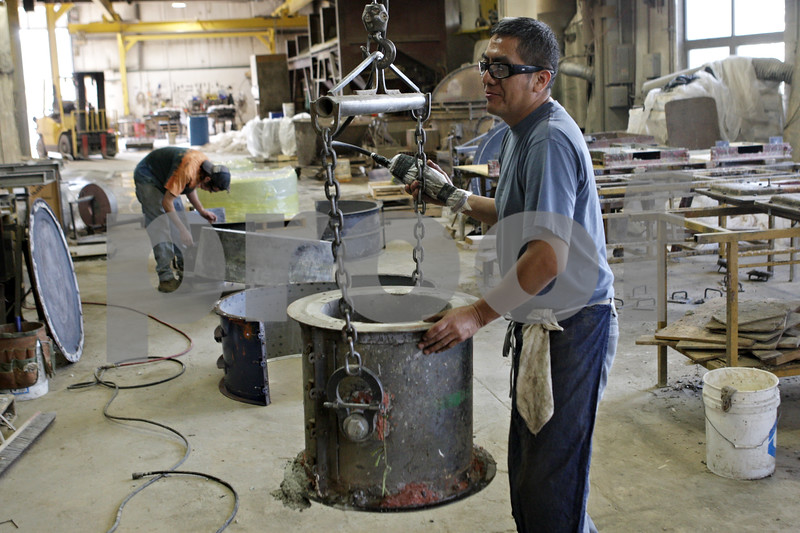 Rob Winner – rwinner@shawmedia.com<br /> <br /> Elias Pedraza, a worker at Doty and Sons in Sycamore, prepares to disassemble a form on Wednesday morning at the shop. The owners of Doty and Sons currently pay for their workers health insurance, but that may change in the coming months.