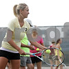 Rob Winner – rwinner@shawmedia.com<br /> <br /> Alexa Farris practices serving during practice at Sycamore High School on Tuesday, Aug. 20, 2013.