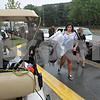 Rob Winner – rwinner@shawmedia.com<br /> <br /> Danyell Mosher, of Twin Lakes, Wis., carries items to a golf cart while unloading her vehicle outside New Residence Hall Community Center on the Northern Illinois University campus in DeKalb, Ill., Thursday, Aug. 22, 2013.