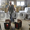 Rob Winner – rwinner@shawmedia.com<br /> <br /> Shawn Sellers, a worker at Doty and Sons in Sycamore, oils a bench mold in the shop on Wednesday morning. The owners of Doty and Sons currently pay for their workers health insurance, but that may change in the coming months.