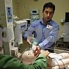 Rob Winner – rwinner@shawmedia.com<br /> <br /> DurRay Sanchez-Torres (left) and Glenn Podzimek demonstrate resuscitation on a baby simulator within Kishwaukee Community Hospital's simulation lab in DeKalb, Ill., Friday, Aug. 16, 2013.