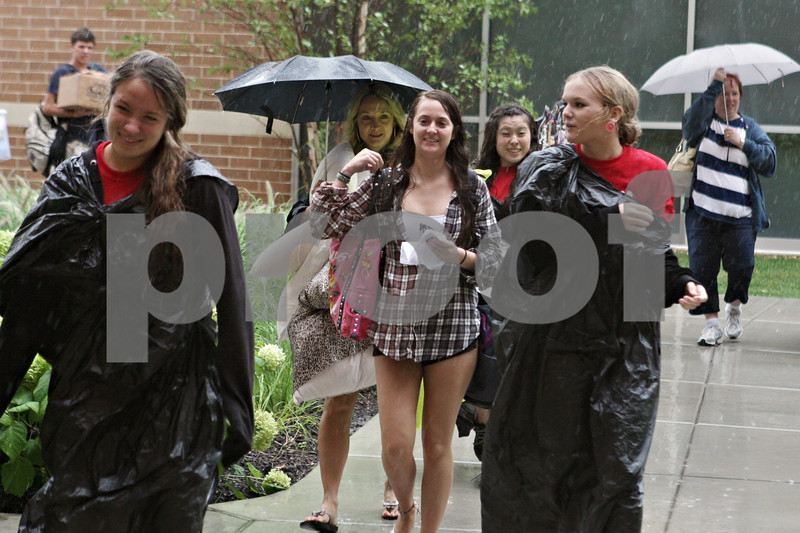 Rob Winner – rwinner@shawmedia.com<br /> <br /> Arielle Litke (center), of Hinsdale, is helped by a group of volunteers including Julie Rauch (right) while moving her items into New Residence Hall East on the Northern Illinois University campus in DeKalb, Ill., Thursday, Aug. 22, 2013.