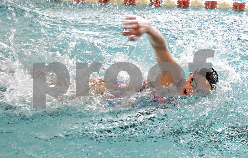 Monica Maschak - mmaschak@shawmedia.com<br /> Sophomore Kylie Olson swings her arm over for her next stroke in the freestyle during a DeKalb-Sycamore co-op swim team practice on Friday, August 16, 2013.