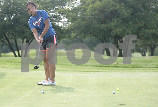 Monica Maschak - mmaschak@shawmedia.com<br /> Senior Katie Thurlby nudges her ball toward the hole during golf practice at Oak Country Club on Tuesday, August 20, 2013. Last year, the Genoa-Kingston girls won their regional championship.