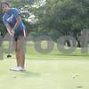Monica Maschak - mmaschak@shawmedia.com<br /> Senior Katie Thurlby nudges her ball toward the hole during golf practice at Oak Country Club on Tuesday, August 20, 2013. Last year, the Genoa-Kingston girls won their regional championship.
