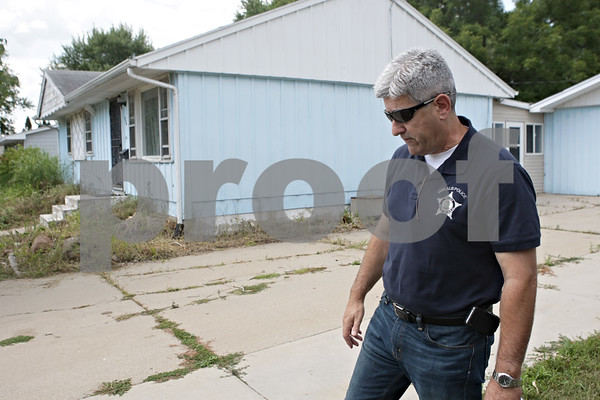 Rob Winner – rwinner@shawmedia.com<br /> <br /> Carl Leoni, the city of DeKalb's Crime Free Housing & Inspection Coordinator, inspects a rental property Friday on Fairlane Avenue in DeKalb. Leoni works with landlords to bring properties up to city code.<br /> <br /> Friday, Aug. 16, 2013