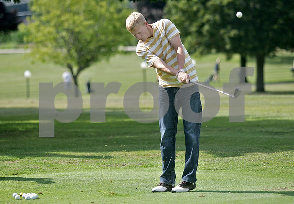 Monica Maschak - mmaschak@shawmedia.com<br /> Junior Jake Wieseler chips balls during a practice for the Indian Creek golf team at Indian Oaks Country Club on Friday, August 16, 2013.