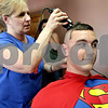 Monica Maschak - mmaschak@shawmedia.com<br /> Stylist Debby Baranowski shaves the head of Superman (Tyler Hunt) at a shave-a-thon fundraiser for three-year-old Dylan Carey at Q Salon and Quinn's Grooming Parlour in Shabbona on Saturday, August 17, 2013. In July of 2013, Carey was diagnosed with neuroblastoma. All the proceeds from the fundraiser went to the Carey family.