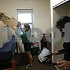 Rob Winner – rwinner@shawmedia.com<br /> <br /> Emma Domonkos (left), of Winfield, and her mother Beverly Domonkos begin sorting Emma's room on the fifth floor of New Residence Hall East on the Northern Illinois University campus in DeKalb, Ill., Thursday, Aug. 22, 2013.