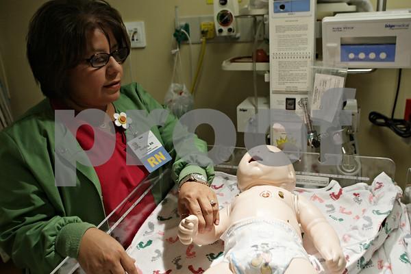 Rob Winner – rwinner@shawmedia.com<br /> <br /> DurRay Sanchez-Torres, RN checks the pulse on the baby simulator within Kishwaukee Community Hospital's simulation lab in DeKalb, Ill., Friday, Aug. 16, 2013.