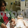 Rob Winner – rwinner@shawmedia.com<br /> <br /> DurRay Sanchez-Torres, RN checks the pulse on the baby simulator within Kishwaukee Community Hospital's simulation lab in DeKalb, Ill., Friday, Aug. 16, 2013.