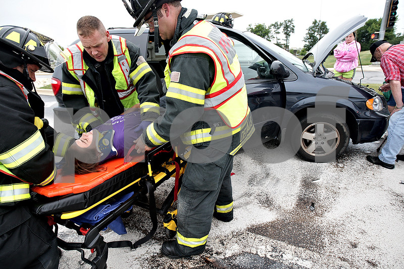 Monica Maschak - mmaschak@shawmedia.com<br /> Mary Reynolds, of DeKalb, is gently removed from her car by DeKalb Fire Department Paramedics following a three-car collision near Kishwaukee Community Hospital on Route 23 in DeKalb on Thursday, August 22, 2013. DeKalb Police and Fire Departments responded to the scene. There were no fatalities.
