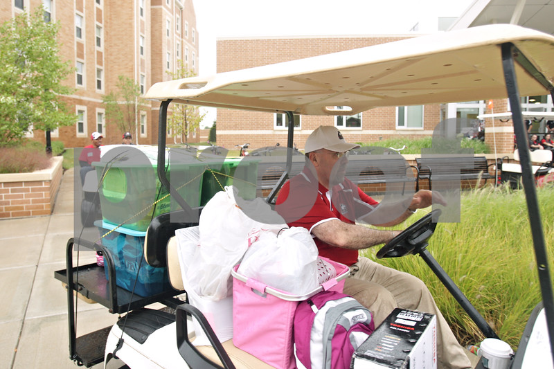 Rob Winner – rwinner@shawmedia.com<br /> <br /> DeKalb Mayor John Rey is seen helping out during Northern Illinois University's move-in day on Thursday, Aug. 22, 2013.