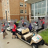 Rob Winner – rwinner@shawmedia.com<br /> <br /> Students, family and volunteers are seen outside New Residence Hall East on the Northern Illinois University campus in DeKalb, Ill., Thursday, Aug. 22, 2013.