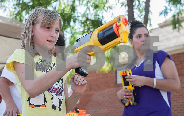 Erik Anderson - For the Daily Chronicle<br /> Jayden Wogen, 9, of DeKalb gets ready to shoot a nerf gun during the block party at the intersection of Somonauk Street and Elm Street in downtown Sycamore on Saturday, August 24, 2013.
