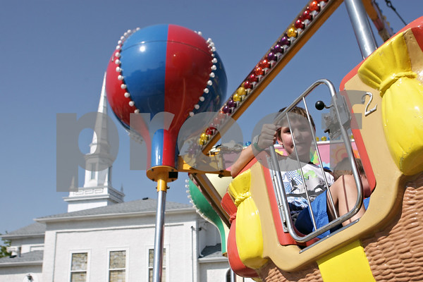 Rob Winner – rwinner@shawmedia.com<br /> <br /> Drake Mickler (left), 8, rides a balloon ride with his brother Aiden, 4, at the carnival during Corn Fest in downtown DeKalb on Friday, Aug. 30, 2013.