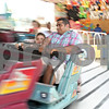 Rob Winner – rwinner@shawmedia.com<br /> <br /> DeKalb resident Nelson Caudillo and his son Holden, 5, ride the Himalaya at the carnival during Corn Fest in downtown DeKalb on Friday, Aug. 30, 2013.