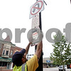 Rob Winner – rwinner@shawmedia.com<br /> <br /> Andy Raih of the City of DeKalb posts a special event no parking sign on the 100 block of East Lincoln Highway in downtown DeKalb on Wednesday, Aug. 28, 2013. A section of Lincoln Highway will be closed beginning Thursday at 3 p.m.