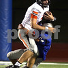 Monica Maschak - mmaschak@shawmedia.com<br /> Quarterback Jack Sauter gets tackled with the ball during the first quarter of their first game at Vernon Hills High School on Friday, August 30, 2013. Game was delayed an hour and fifty-two minutes due to inclement weather.