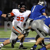 Monica Maschak - mmaschak@shawmedia.com<br /> Linebacker Jake Kuykendall reaches for the ball carrier during the first quarter of their first game at Vernon Hills High School on Friday, August 30, 2013. Game was delayed an hour and fifty-two minutes due to inclement weather.