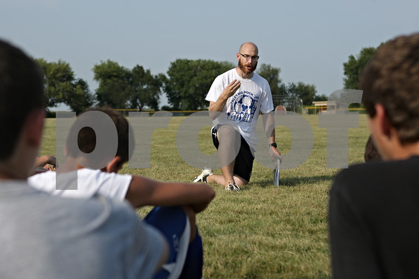 Rob Winner – rwinner@shawmedia.com<br /> <br /> Hinckley-Big Rock soccer coach Paul Taeuber talks to his player between drills during practice in Hinckley on Tuesday, Aug. 20, 2013.