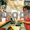 Rob Winner – rwinner@shawmedia.com<br /> <br /> Sales clerk Patty Kirk removes a receipt from the cash register printer after a purchase at Moxie in downtown DeKalb on Monday, Aug. 26, 2013.