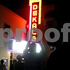 "Monica Maschak - mmaschak@shawmedia.com<br /> A crowd cheers when the word, ""DeKalb"" appears in lights at a relighting ceremony to officially light the restored marquee of the former DeKalb Theatre, which now houses the Debutantes School of Cosmotology and Nail Technology, on Thursday, August 29, 2013. The theatre opened in March 1949, but the marquee has been dark since 1991 as several other businesses have operated there. DeKalb restored the marquee using TIF funds and Debutantes has promised to pay the operating costs."